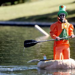 Kyle Fox tests out his pumpkin before the start of the 2013 Mountain Valley Seed Co. Ginormous Pumpkin Regatta at Sugarhouse Park on Saturday, October 19, 2013.