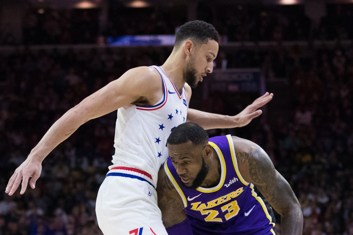 Los Angeles Lakers forward LeBron James controls the ball against Philadelphia 76ers guard Ben Simmons during the second quarter at Wells Fargo Center.