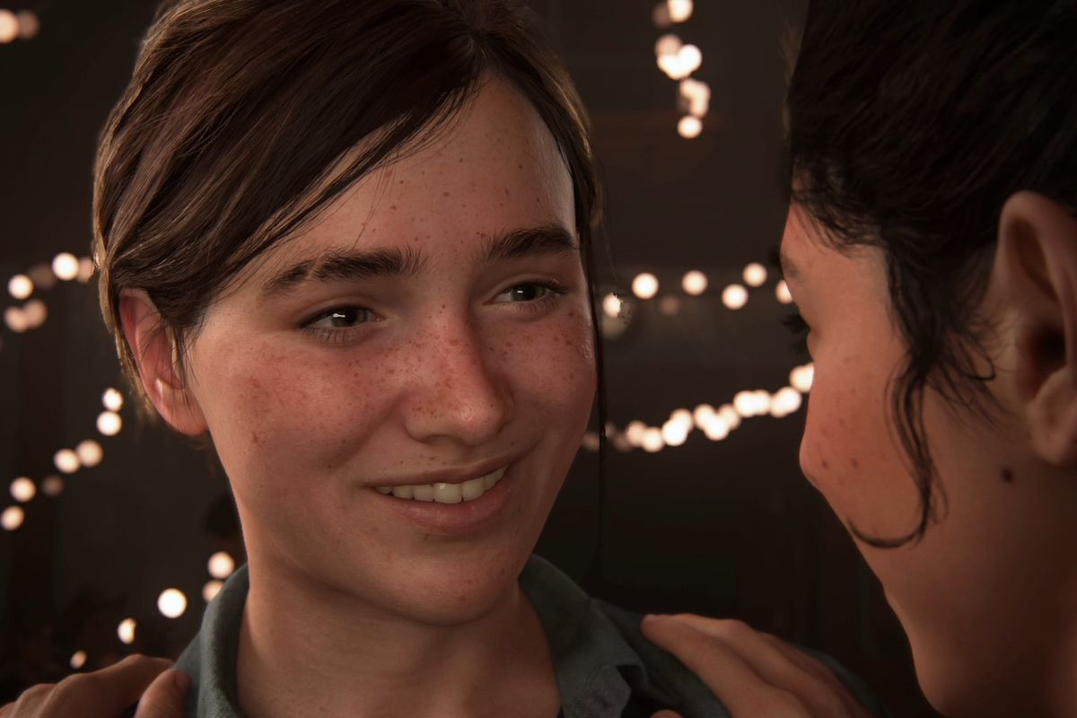 The Last of Us Part 2 - Ellie and Dina smiling at each other on the dance floor
