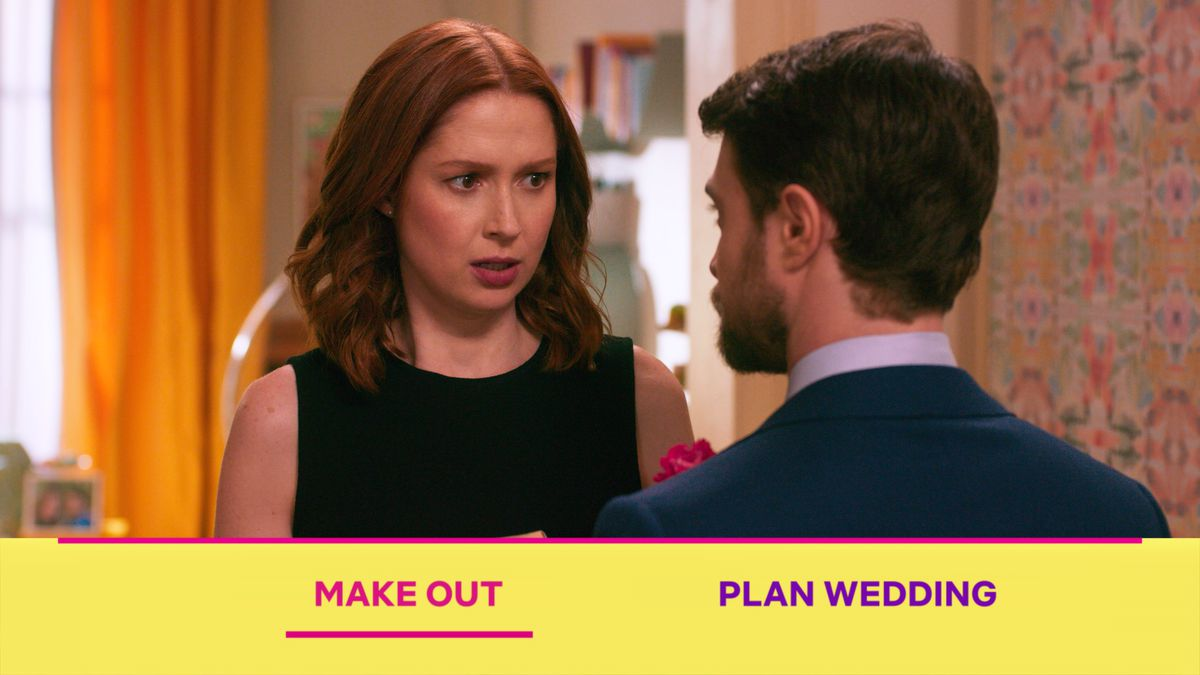 """Ellie Kemper looks at Daniel Radcliffe in the Unbreakable Kimmy Schmidt interactive special, as the viewer is asked to choose between """"Make out"""" and """"Plan wedding."""""""