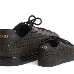 """For the matchy-matchy dad with a tot: AKID Father's Day Birdie Shoe set, <a href=""""http://shop.akidbrand.com/jzv/p/64/Shop/footwear/Father%27s+Day+Birdie+Set+%28Black+Laser%29?p=YzE9MzE="""">$150</a>"""