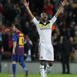 Chelsea's Ashley Cole, right, celebrates besides Barcelona's Lionel Messi from Argentina, left, during a Champions League second leg semifinal soccer match at Camp Nou stadium, in Barcelona, Spain, Tuesday, April 24, 2012.
