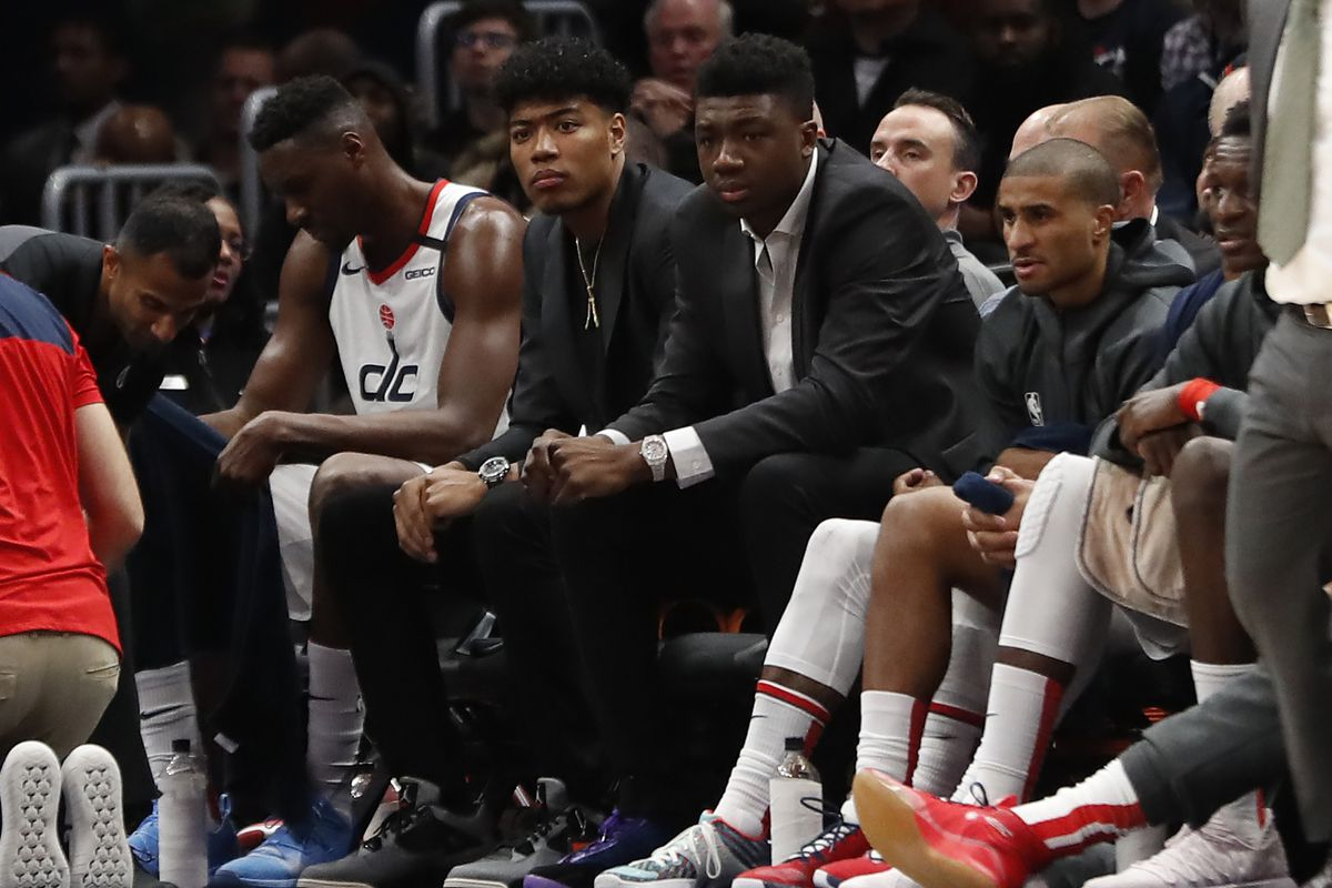 Injured Washington Wizards forward Rui Hachimura and Wizards center Thomas Bryant watch from the bench against the Portland Trail Blazers in the third quarter at Capital One Arena.