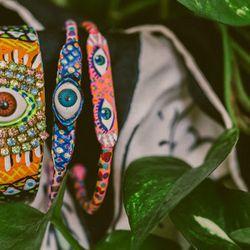 "<b>The Picks:</b> 'Universe' cuff, $285; 'Vintage Eye' bangle, $115; 'Eye See' bangle, <a href=""http://www.susanalexandra.com/products/jgm9jjdhjdl3sihiq7ombmdb1hfhvq"">$97</a>"