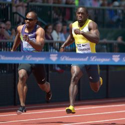 Nickel Ashmeade, right, defeats Walter Dix to win the 200m in the 39th Prefontaine Classic in Eugene, Ore.
