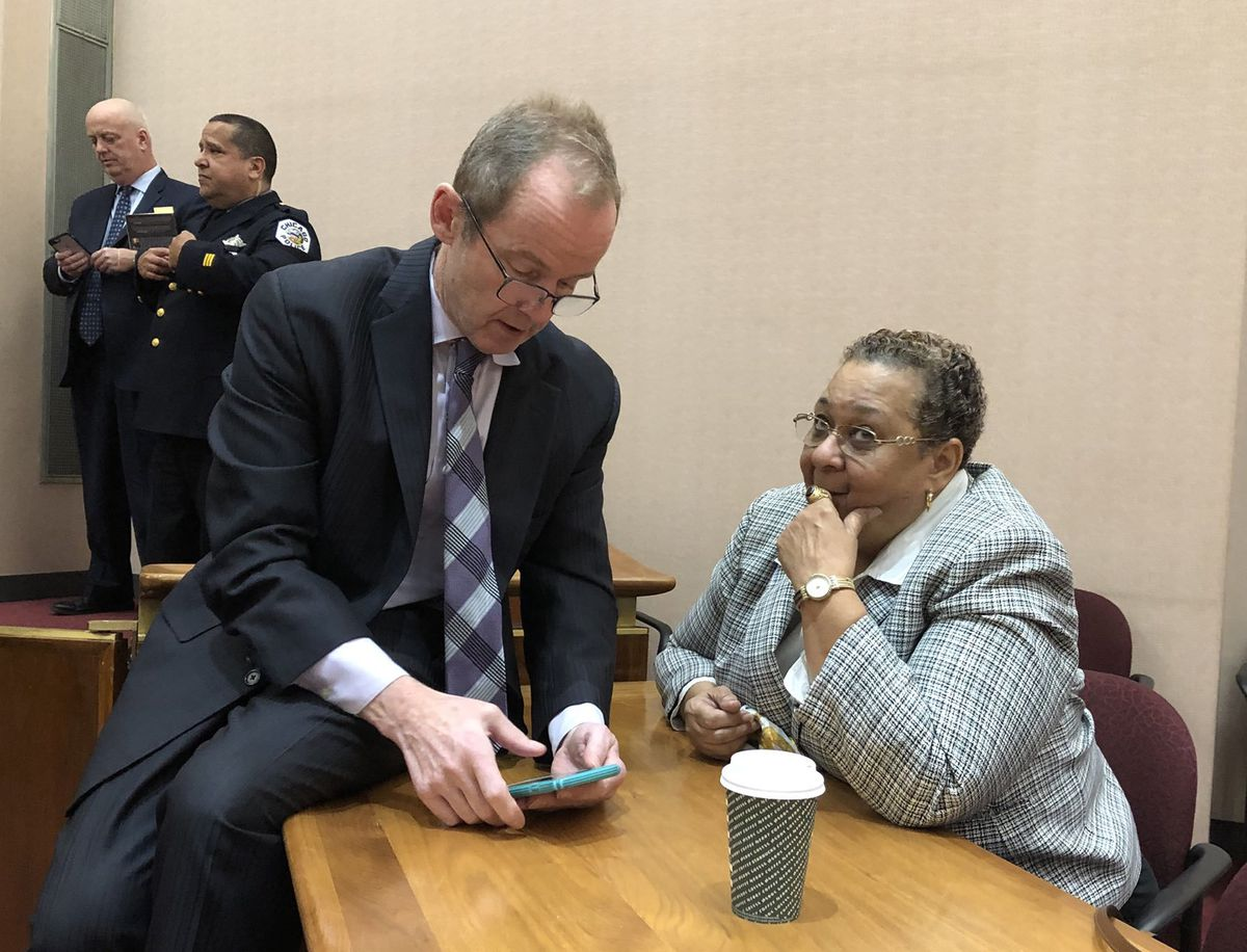 Ald. Tom Tunney (44th), shown visiting during Wednesday's City Council meeting with former 16th Ward alderman Shirley Coleman.