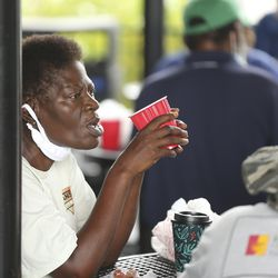 A woman sips coffee in a common area at Community First! Village in Austin, Texas, on Tuesday, Oct. 20, 2020.