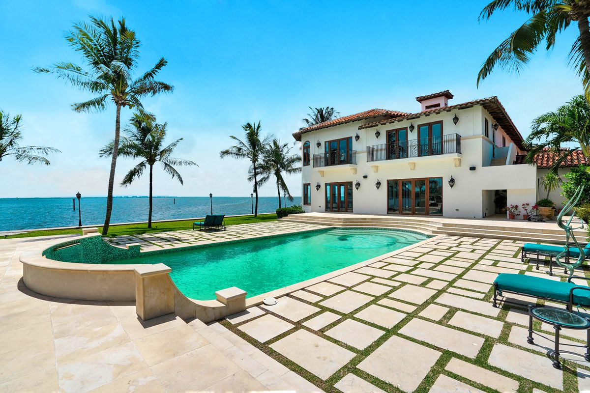 A waterfront Mediterranean in Coconut Grove with a pool by the bay