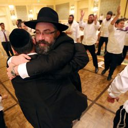 Rabbi Benny Zippel gets a hug during the traditional Hasidic wedding of his daughter, Chaya Zippel, and Rabbi Mendy Cohen at the Grand America Hotel in Salt Lake City on Monday, Sept. 12, 2016.