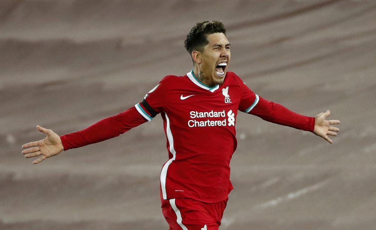 Roberto Firmino of Liverpool celebrates after scoring their team's second goal during the Premier League match between Liverpool and Tottenham Hotspur at Anfield on December 16, 2020
