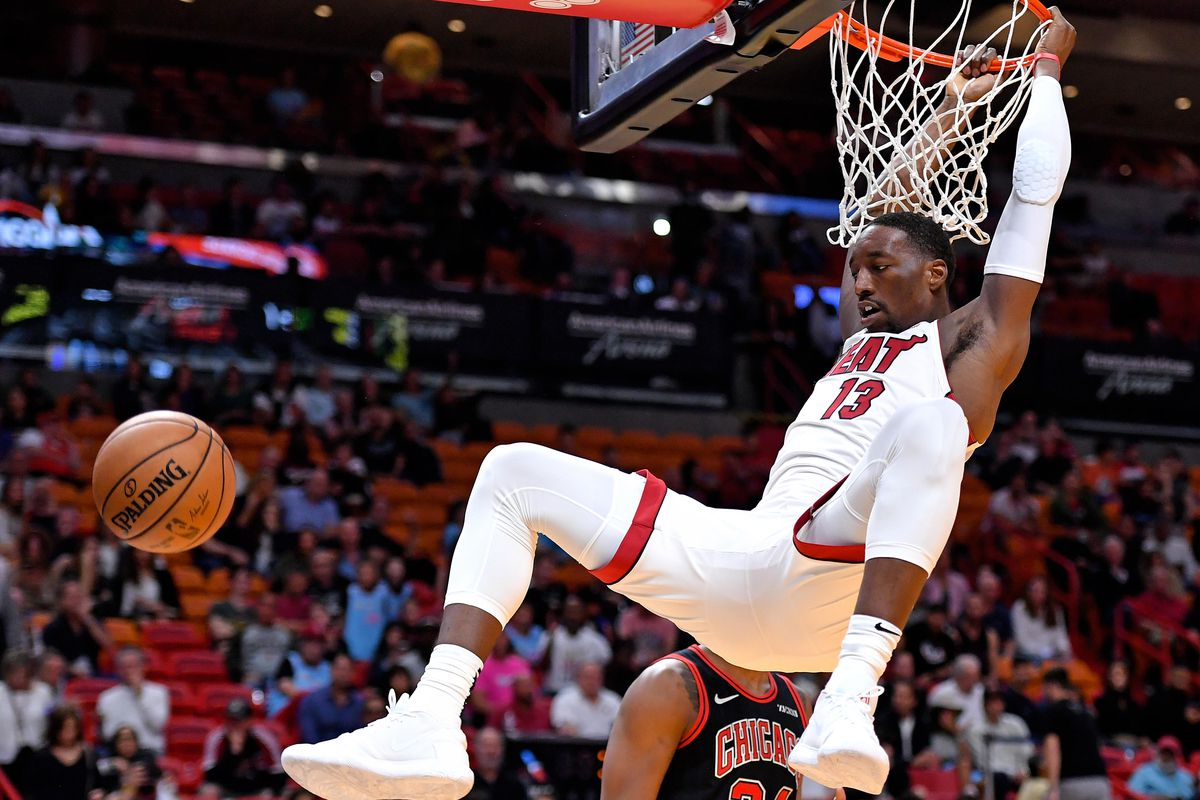 Miami Heat center Bam Adebayo dunks the ball as Chicago Bulls center Wendell Carter Jr. looks on during the second half at American Airlines Arena.