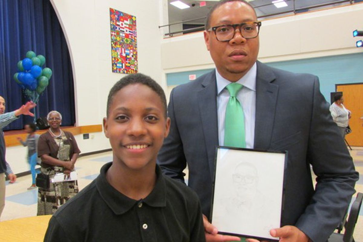 Eric Best drew a portrait of of IPS Superintendent Lewis Ferebee and presented it to him.