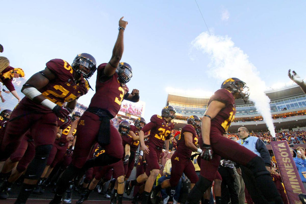 FILE - In this Sept. 22, 2012, file photo, Minnesota players take the field for an NCAA football game against Syracuse in Minneapolis. Minnesota enters Big Ten play as one of only three unbeaten teams in the conference, bringing plenty of confidence into