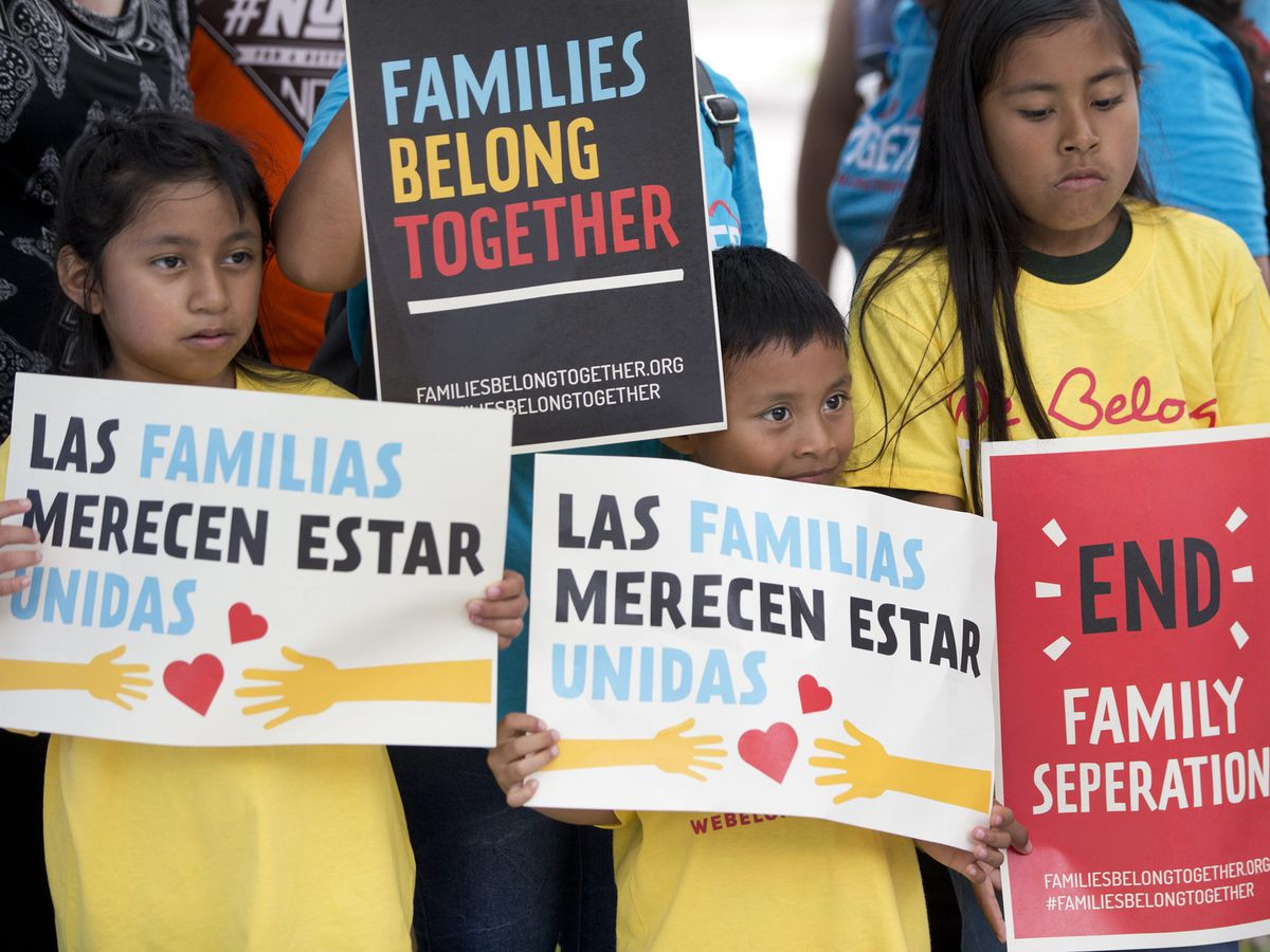 Children hold signs during a demonstration in front of the Immigration and Customs Enforcement offices in Miramar, Fla. The Trump administration's move to separate immigrant parents from their children on the U.S.-Mexico border has turned into a full-blow