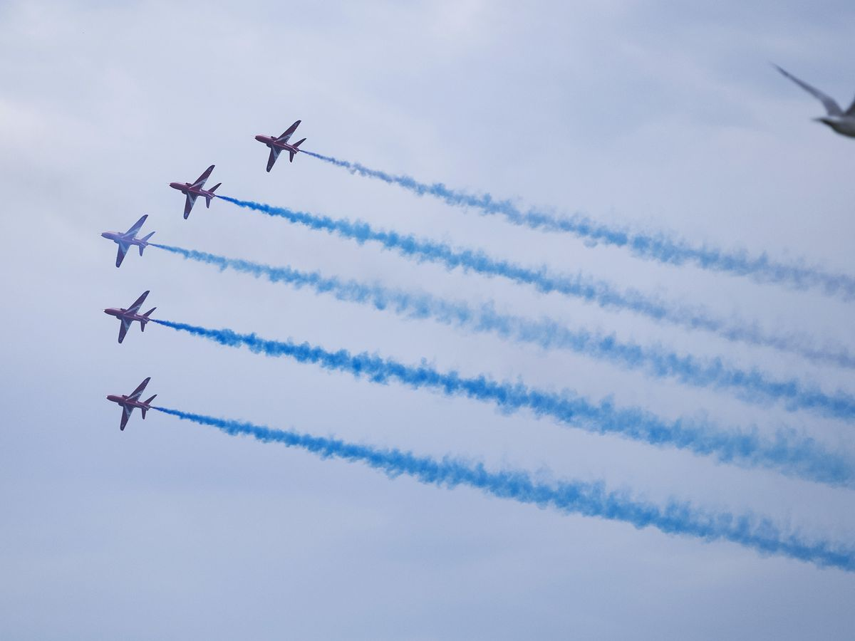 The Royal Air Force Red Arrows release a stream of color Saturday, Aug. 17, 2019 at the 61st Chicago Air and Water show off North Avenue Beach.