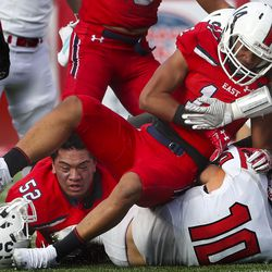 East High School's Vi Tunuufi, left, gets his helmet knocked off during 6A football state semifinal game against American Fork at Rice-Eccles Stadium in Salt Lake City on Friday, Nov. 15, 2019. The Cavemen defeated Tunuufi's Leopards, advancing to the championship game.