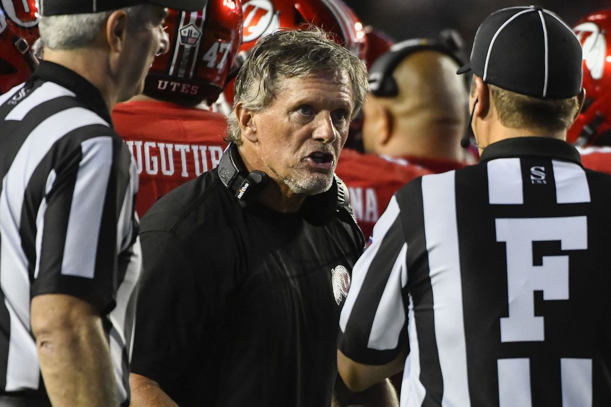 Utah coach Kyle Whittingham speaks to the referees during game against BYU game Saturday, Sept. 11, 2021, in Provo, Utah.