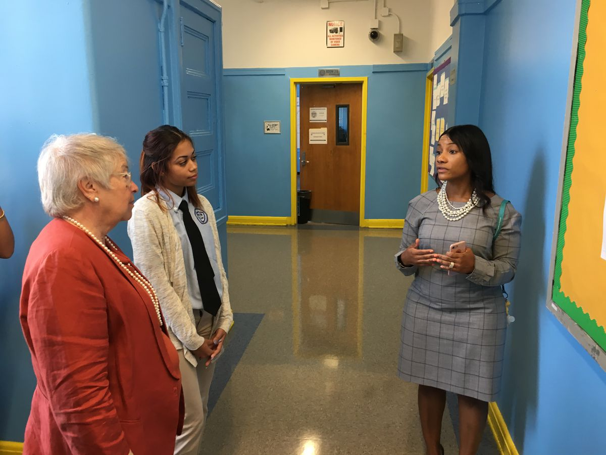Schools Chancellor Carmen Fariña tours Longwood Prep with Principal Asya Johnson (right) and student Heaven Molina.