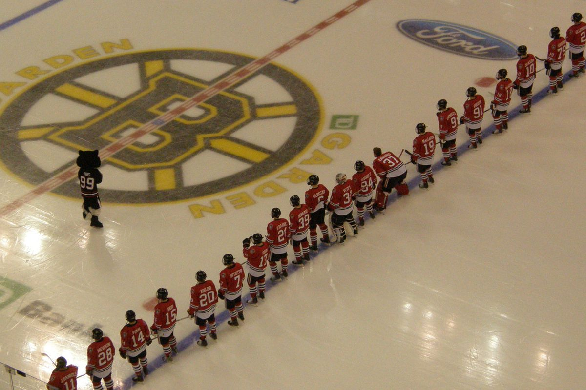 Northeastern players stand at the blue line prior to the Beanpot.