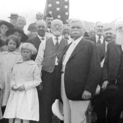 """B. H. Roberts stands front and center with a crowd in the mid 1920's in front of the first """"This is the Place"""" monument which is to be dedicated. The Ottinger collection."""