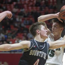Bountiful's David Stevenson and Olympus' Rylan Jones fight for control of the ball during the Olympus Titans' 79-43 victory against the Bountiful Braves in the Class 5A state semifinals at the Jon M. Huntsman Center in Salt Lake City on Friday, March 2, 2018.