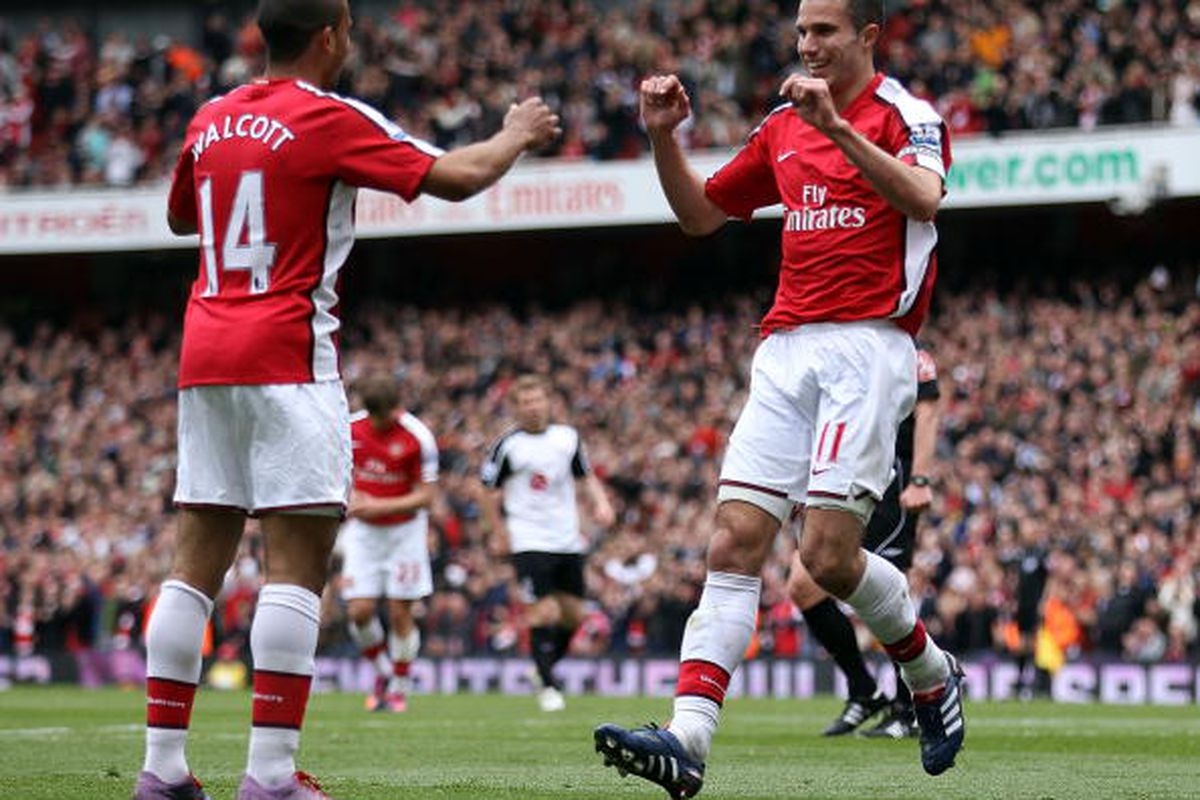 Van Persie and Walcott celebrate the Dutchman's tenth goal.  (Photo by David Cannon/Getty Images)