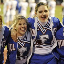 Kennedy Hansen, second from right, has fun cheering with her squad members (from left) Jaycee Gochis, Kendee Sanders and Maci Wilie during the Fremont vs. Viewmont football game on Wednesday, Oct. 16, 2013. In June 2013, when Kennedy Hansen was 15 years old, she was diagnosed with juvenile Batten disease, a rare disorder that generally doesn't manifest itself for the first five to 10 years of a child's life. She died a year later.