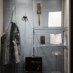 An apron, keys, a paintbrush and other memorabili that were used by Pullman Palace Car Company workers are on display at the Pullman National Monument's visitor's center during the Pullman National Monument's opening day in the Pullman neighborhood, Saturday afternoon, Sept. 4, 2021.