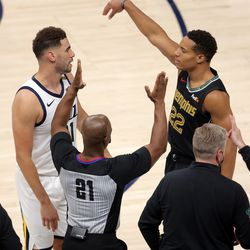 Utah Jazz forward Georges Niang (31) and Memphis Grizzlies guard Desmond Bane (22) have words after Bane drained a three point shot on him as the Utah Jazz and the Memphis Grizzlies play in game one of their NBA playoff series at Vivint Arena in Salt Lake City on Sunday, May 23, 2021. Memphis won 112-109.
