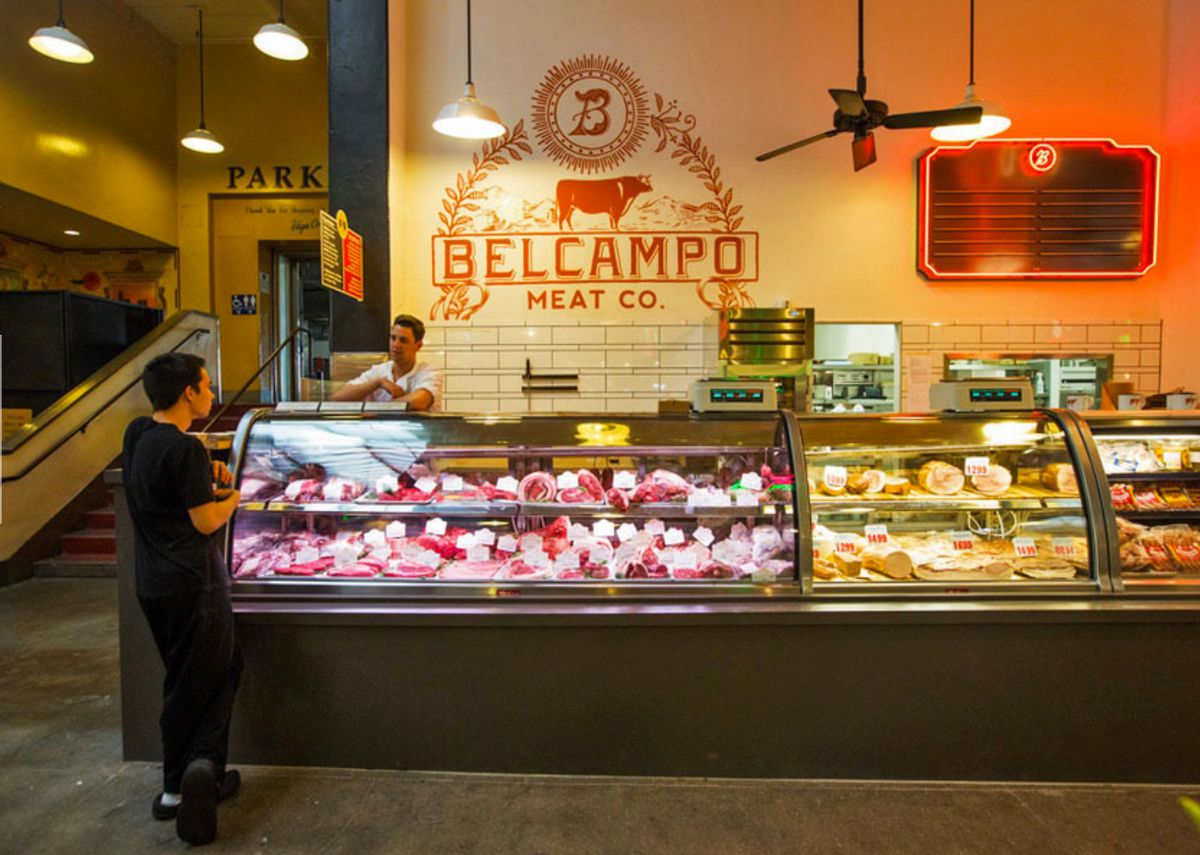Belcampo Meat Co. in 2014 at Grand Central Market in Downtown Los Angeles with a customer interacting with an employee