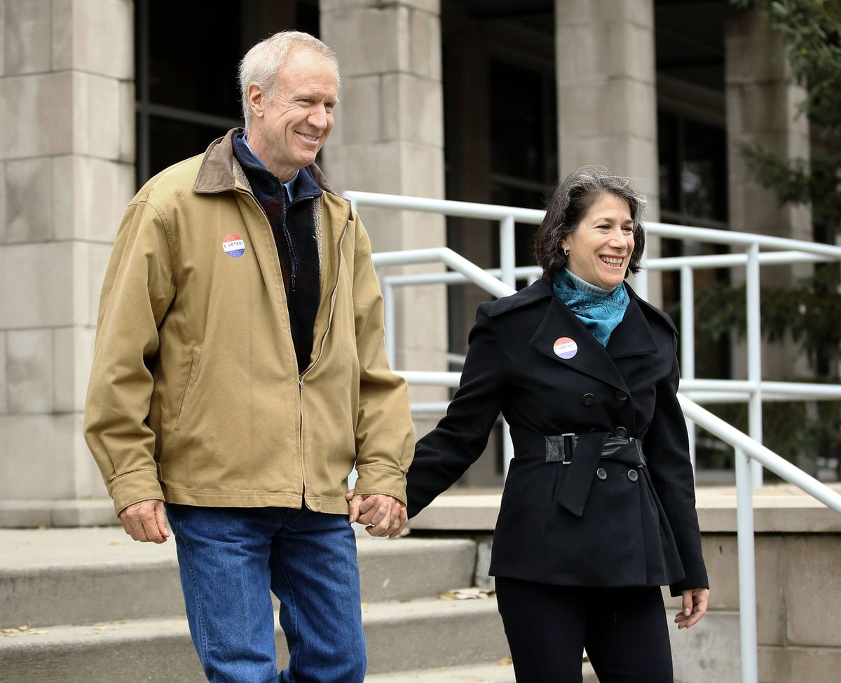 Gov. Bruce and Diana Rauner leave the Divine Mercy Parish Center after voting in Winnetka Tuesday November 6, 2018. | Kevin Tanaka/For the Sun Times