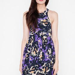 """This Shona Joy high-low number works on so many levels. The purple background can mask red wine splashes, the pattern is inviting, and the racerback design will show off your gorgeous shoulders. $146 at <a href=""""https://www.shopacrimony.com/products/shona"""
