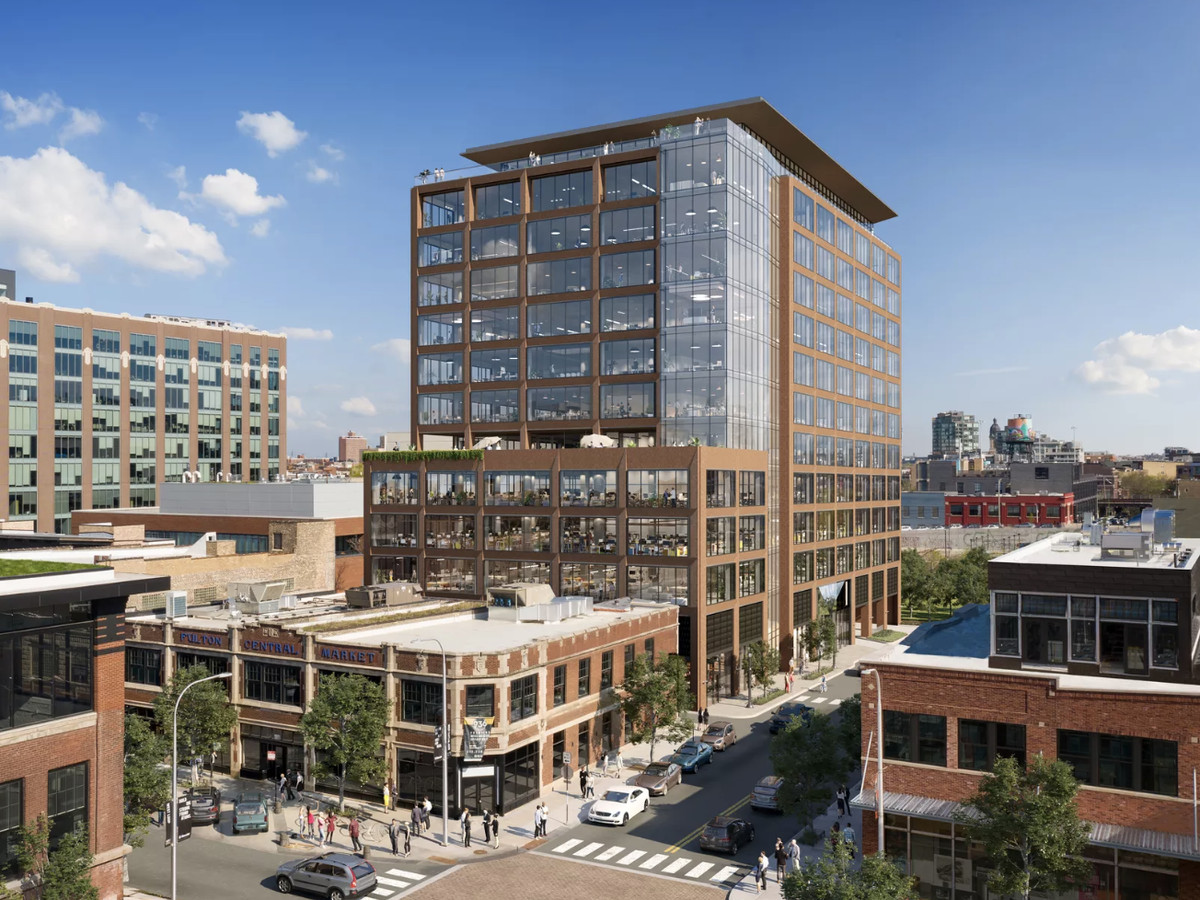 A 13-story office building with a brick and glass facade and a rooftop terrace.