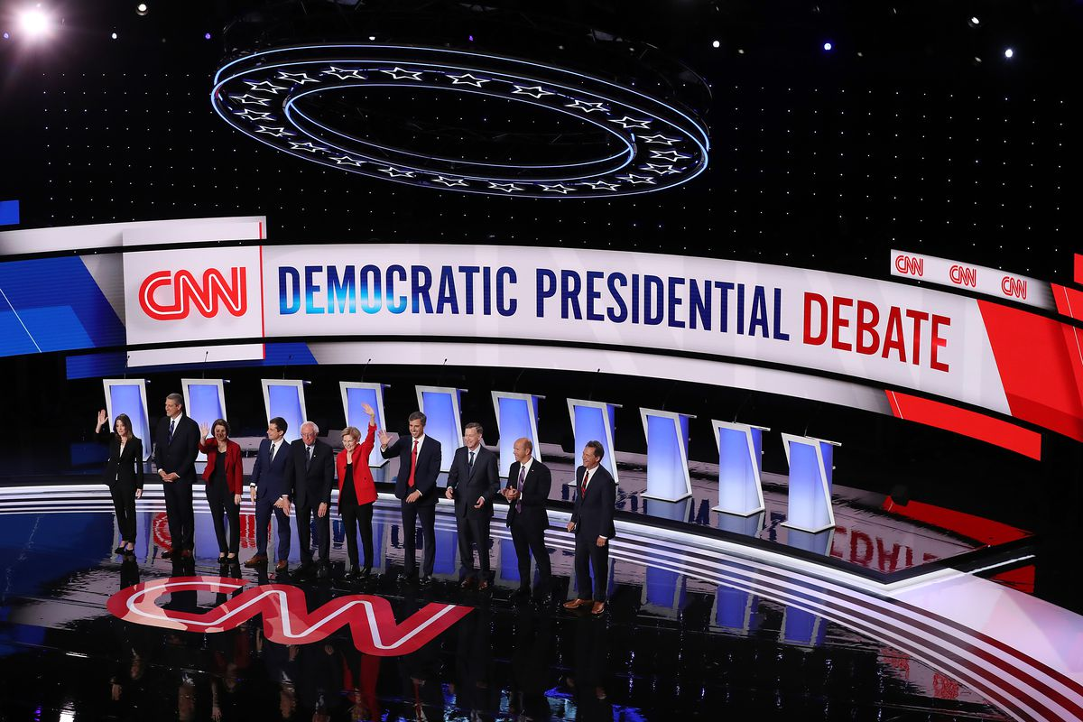 The Democratic debate stage with all the candidates lined up seen from on high.