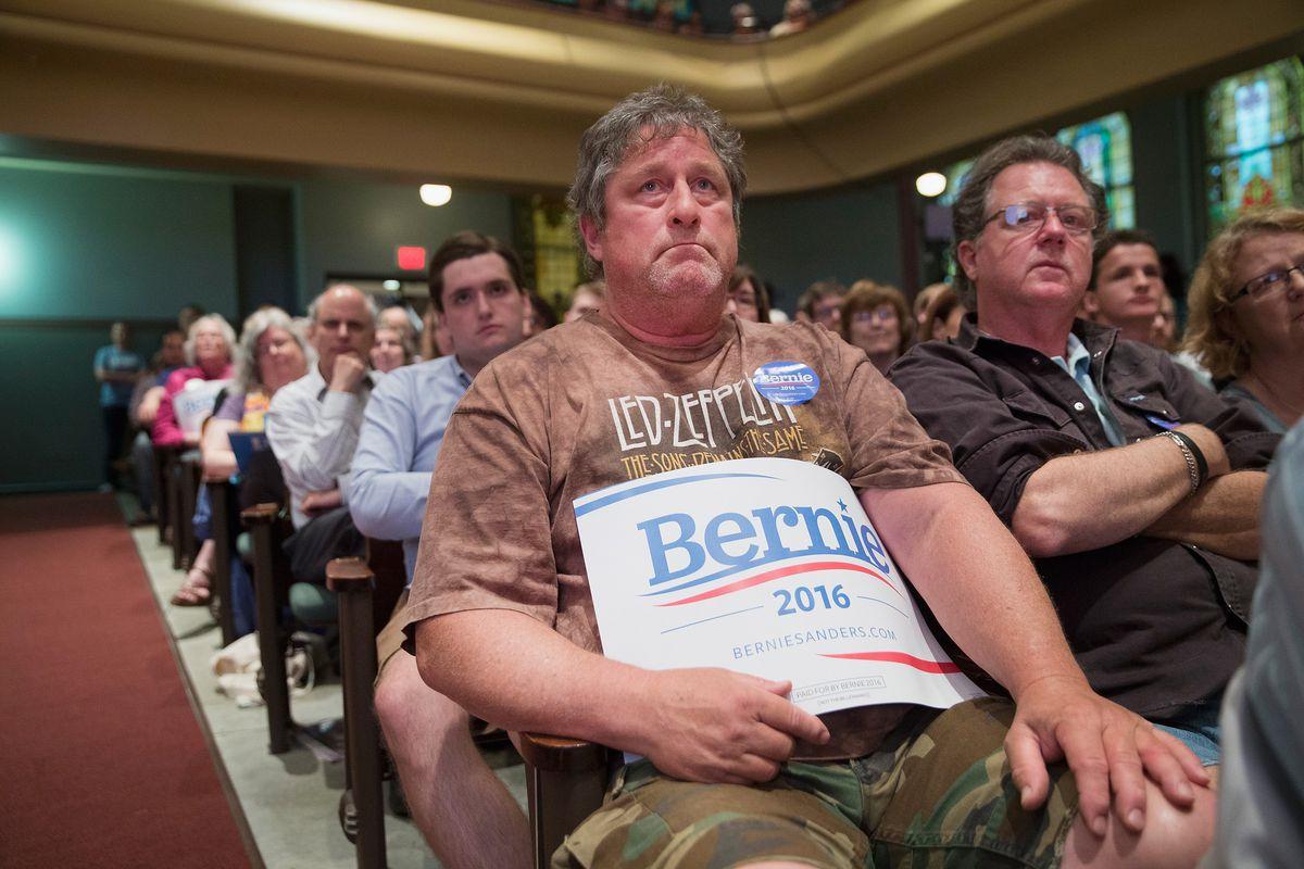 Guests listen as Senator Bernie Sanders (D-VT) speaks at a campaign event at Drake University on June 12, 2015, in Des Moines, Iowa.