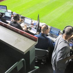 9:56 p.m.: The broadcast crew at work, laptops and monitors at the ready