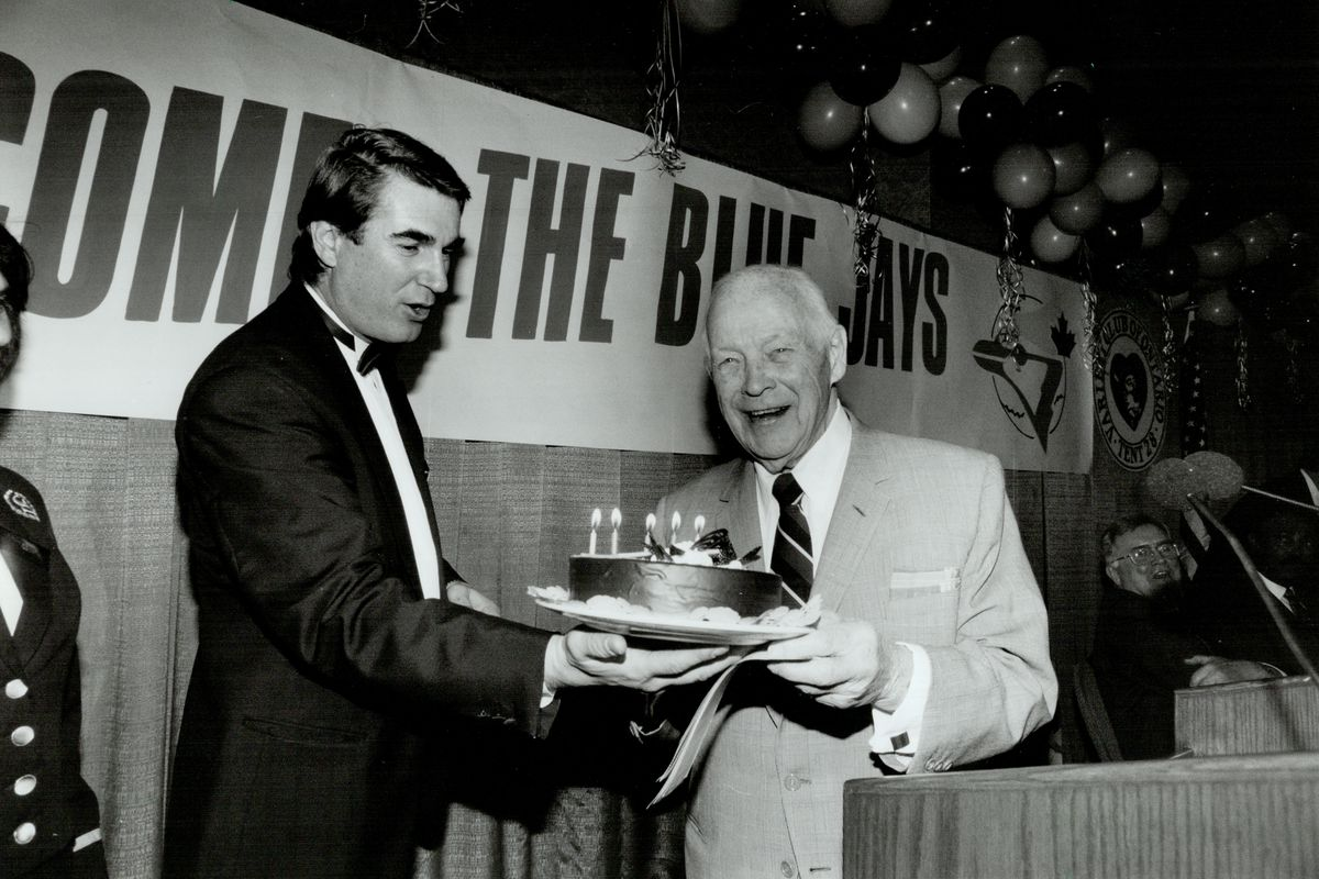 Lampy's light still shines. Allan Lamport; right; accepts 91st birthday cake from Daniel Zamfir yest