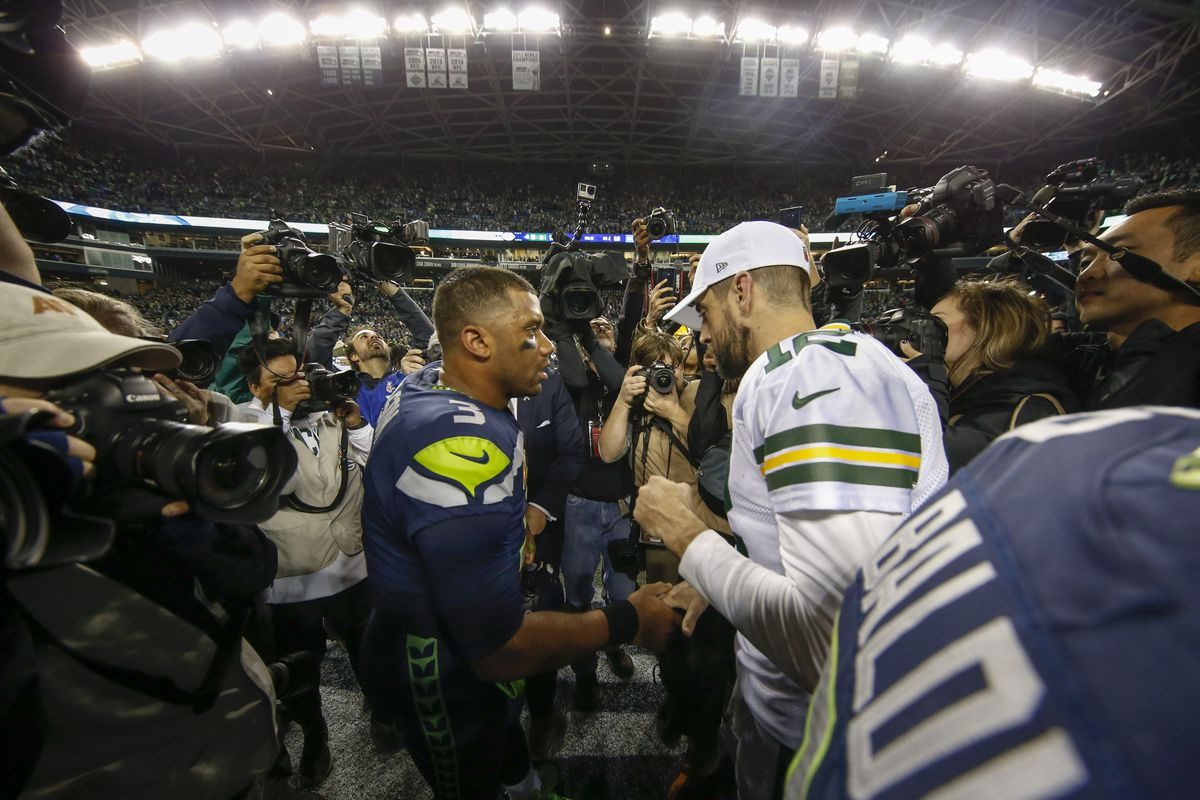 Seattle Seahawks quarterback Russell Wilson shakes hands with Green Bay Packers quarterback Aaron Rodgers following a 27-24 Seattle victory at CenturyLink Field.