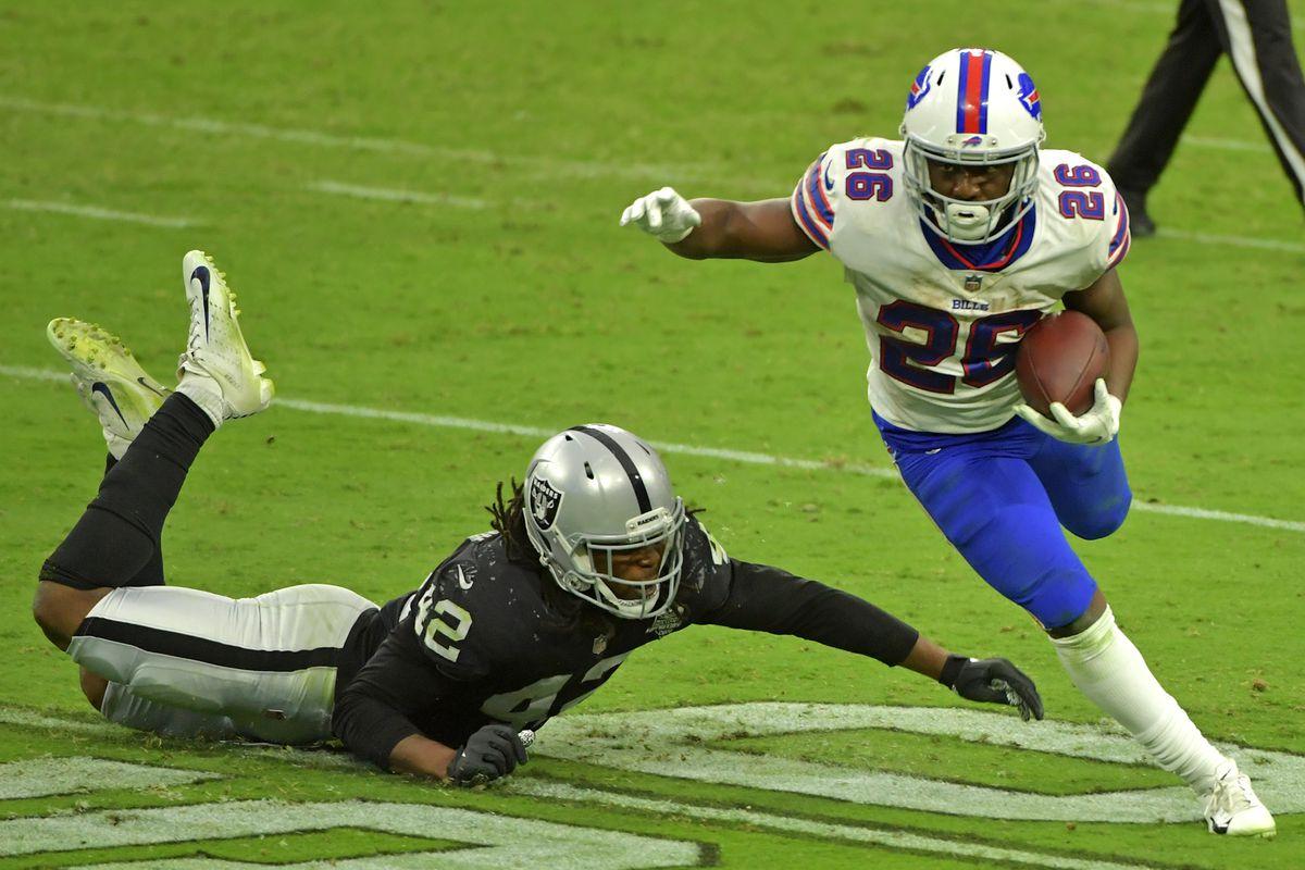Buffalo Bills running back Devin Singletary shakes the tackle of Las Vegas Raiders inside linebacker Cory Littleton during the fourth quarter at Allegiant Stadium