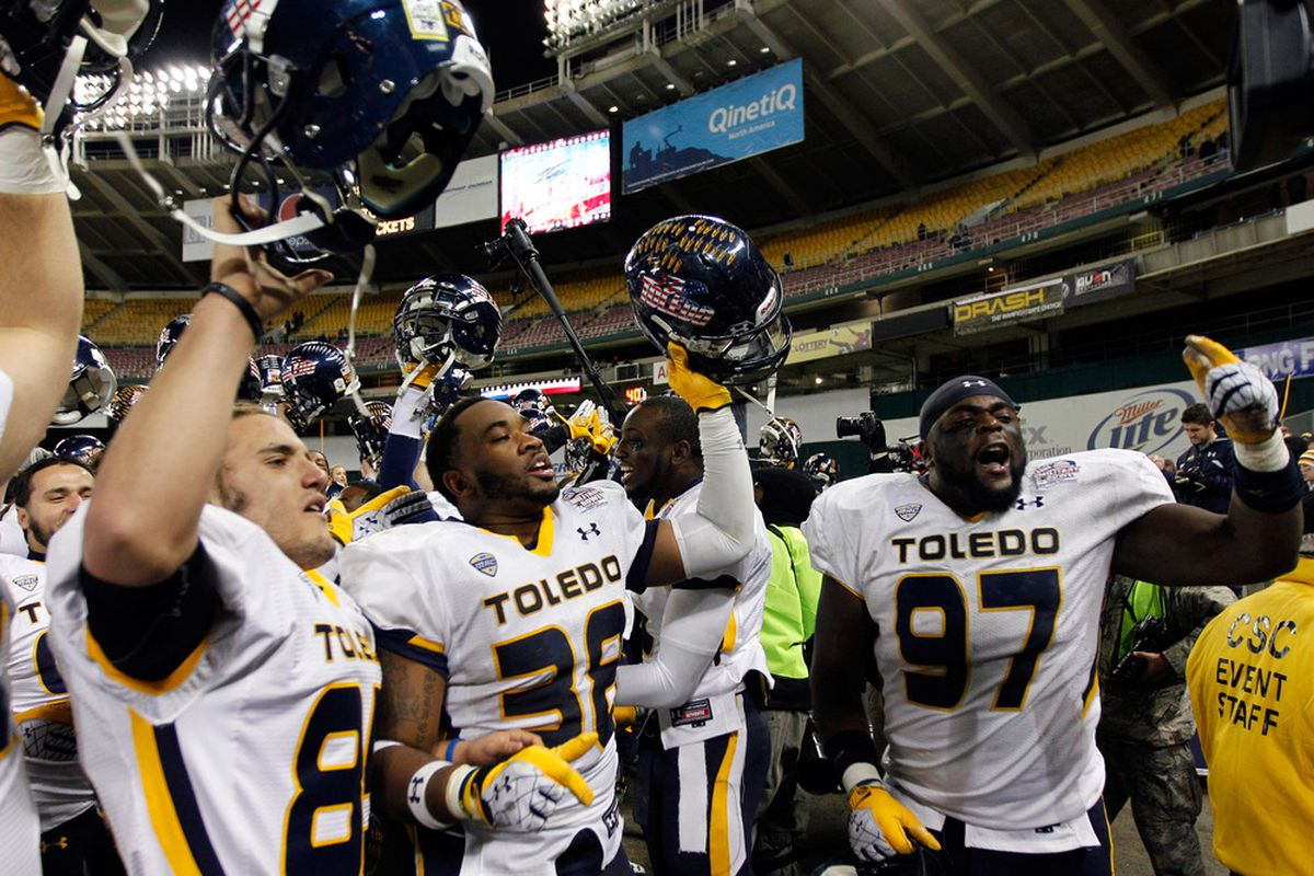 WASHINGTON, DC - DECEMBER 28: Members of the Toledo Rockets celebrate their 42-41 win over the Air Force Falcons in the Military Bowl at RFK Stadium on December 28, 2011 in Washington, DC.  (Photo by Rob Carr/Getty Images)