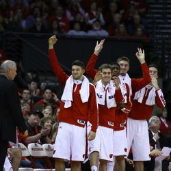 The Wisconsin bench celebrates a 3 point shot.