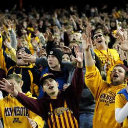 Minnesota student fans cheer during the second half of an NCAA college football game against Syracuse in Minneapolis, Saturday Sept. 22, 2012. Minnesota defeated Syracuse 17-10.