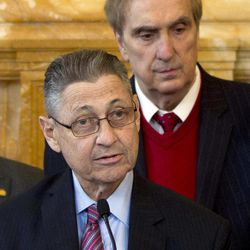 FILE - In this April 18, 2012 file photo, Assembly Speaker Sheldon Silver, D-Manhattan, speaks during an affordable housing news conference as Assemblyman Vito Lopez, D-Brooklyn, right, listens at the Capitol in Albany, N.Y.  Accusations of sexual harassment that emerged over the summer have unraveled in public before a state ethics committee, revealing more sexual misconduct accusations against Lopez and a secret six-figure payoff to the accusers with taxpayer money that was approved by Silver.