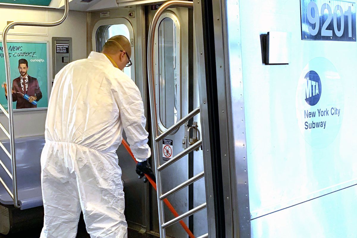 A worker cleans up a soiled subway car at Stillwell Avenue in Coney Island.