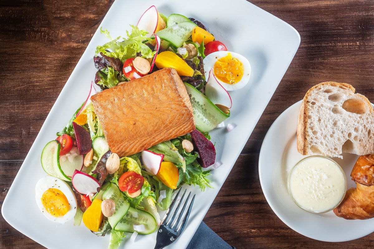 A house-smoked salmon salad is an entree on the lunch menu.
