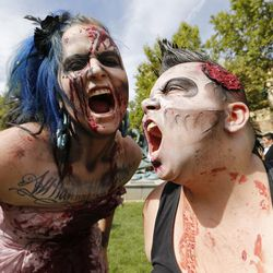 Aubrey Stowers and Maizie Alonzo participate in the Zombie Walk in Salt Lake City Sunday, Aug. 30, 2015. The eighth annual Zombie Walk was held to raise awareness and donations for the Utah Food Bank.