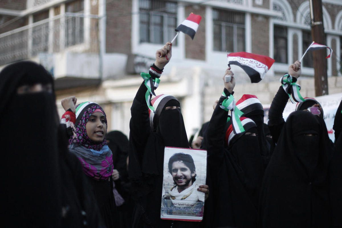 Protestors chant slogans during a rally to commemorate the one year anniversary of the people who were killed in clashes with Yemeni government forces in Sanaa, Yemen, Tuesday, Sept. 18, 2012. Yemeni government forces opened fire with anti-aircraft guns a