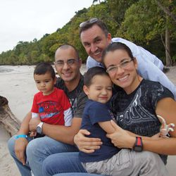 Producer Jeff Roberts, center back, with Carolina Muñoz Marin and her family in Costa Rica. Marin has fought her way to the top of women's amateur kickboxing in Costa Rica, challenging the traditional stereotypes of a Mormon woman.
