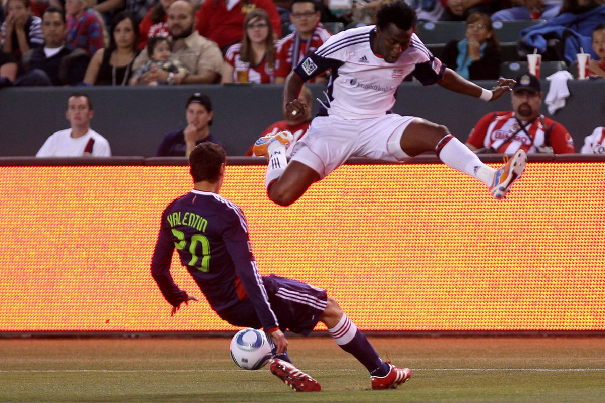 CARSON, CA - APRIL 30:    Zarek Valentin #20 of Chivas USA tackles the ball away from Kenny Mansally #7 of the New England Revolution at The Home Depot Center on April 30, 2011 in Carson, California.    (Photo by Stephen Dunn/Getty Images)