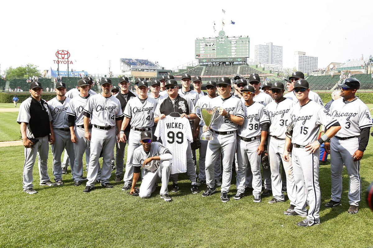 CHICAGO, IL - MAY 20:  The Chicago White Sox celebrate winning the winning the BP Cup over the Chicago Cubs during an interleague game at Wrigley Field on May 20, 2012 in Chicago, Illinois. (Photo by Mike McGinnis/Getty Images)